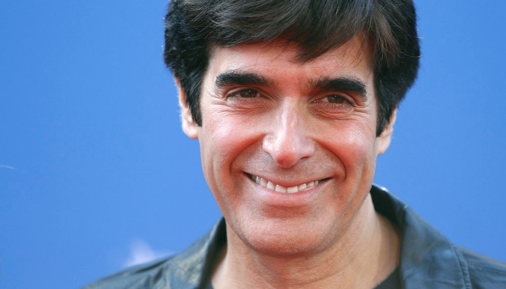 """. Magician David Copperfield arrives for the premiere of the film \""""The Croods\"""" in New York, March 10, 2013. REUTERS/Carlo Allegri"""