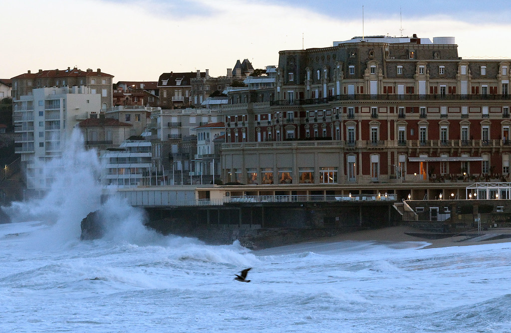. Big waves crash on the seafront in Biarritz, southwestern France, Tuesday, Jan. 7, 2014. There has been a weather alert for high waves in the south west of France since Monday. (AP Photo/Bob Edme)