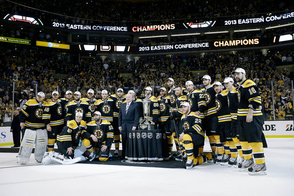 . The Boston Bruins pose with the trophy after beating the Pittsburgh Penguins 1-0 in Game 4 of the Eastern Conference finals of the NHL hockey Stanley Cup playoffs, in Boston on Friday, June 7, 2013. The Bruins advanced to the Stanley Cup finals. (AP Photo/Elise Amendola)