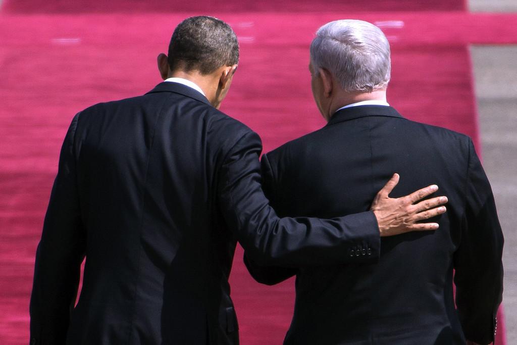 . US President Barack Obama (L) walks alongside Israeli Prime Minister Benjamin Netanyahu during a welcome ceremony at Israel�s International Ben Gurion airport on March 20, 2013.  AFP PHOTO/JACK GUEZ/AFP/Getty Images