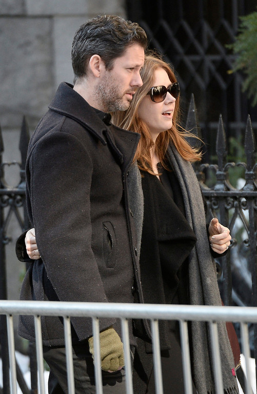 . US actress Amy Adams and husband Darren Le Gallo (L) arrive for the Funeral Mass for US Actor Phillip Seymour Hoffman at St Ignatius Church in New York, New York, USA 07 February 2014. Hoffman, 46, died 02 February from a suspected drug overdose.  EPA/ANDREW GOMBERT