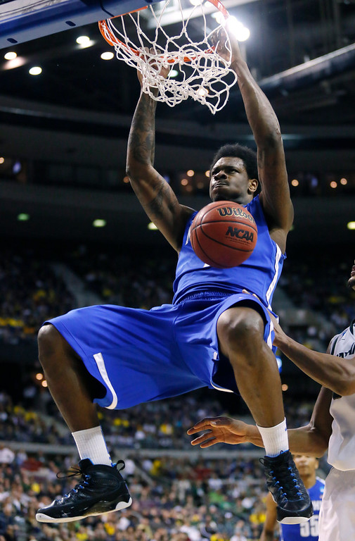 . Memphis forward Tarik Black dunks against Michigan State in the second half of a third-round game of the NCAA college basketball tournament Saturday, March 23, 2013, in Auburn Hills, Mich. Michigan State defeated Memphis 70-48. (AP Photo/Duane Burleson)
