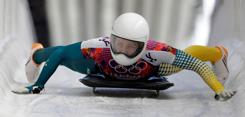 . Michelle Steele of Australia brakes in the finish area after her first run during the women\'s skeleton competition at the 2014 Winter Olympics, Thursday, Feb. 13, 2014, in Krasnaya Polyana, Russia. (AP Photo/Natacha Pisarenko)