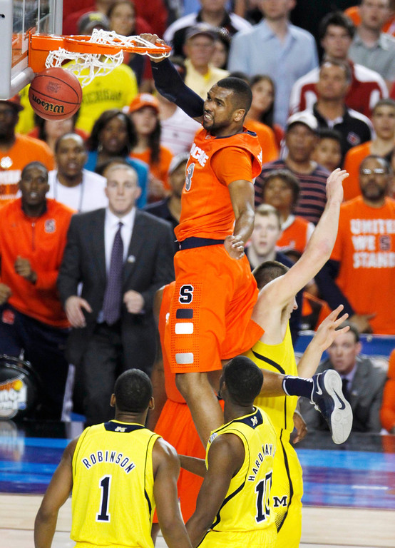 . Syracuse Orange forward James Southerland (43) dunks against the Michigan Wolverines in the second half of their NCAA men\'s Final Four basketball game in Atlanta, Georgia April 6, 2013.  REUTERS/Tami Chappell