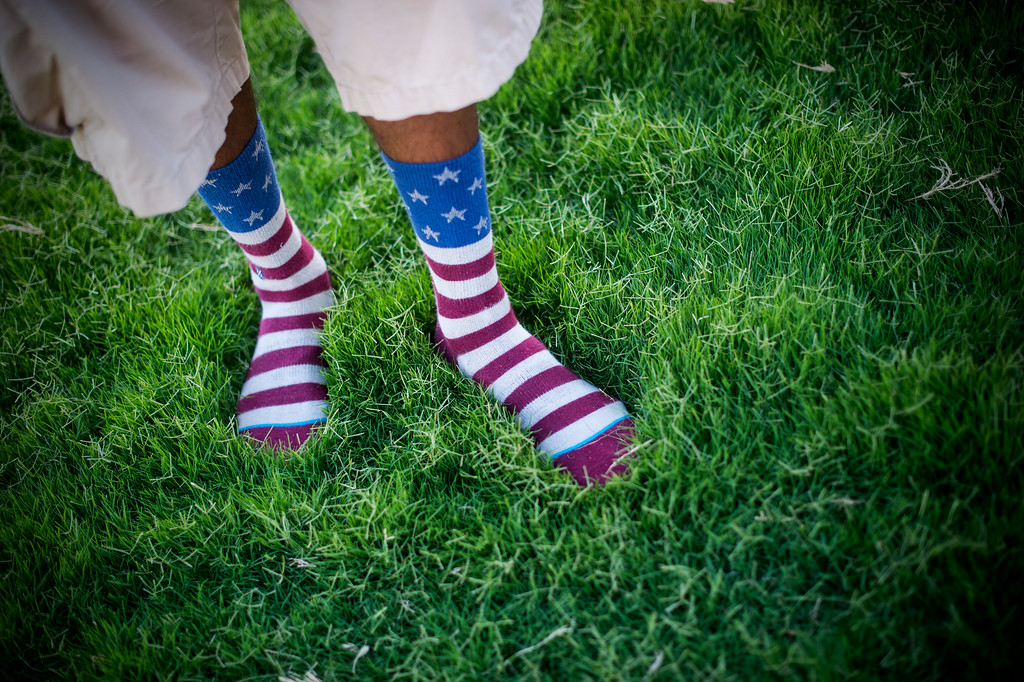 . Chase Thomas, of Los Angeles, wears patriotic socks as he waits for Americafest\'s annual fireworks show at the Rose Bowl in Pasadena Friday night, July 4, 2014. (Photo by Sarah Reingewirtz/Pasadena Star-News)