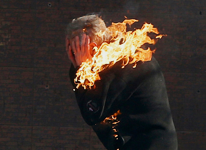 . An anti-government protester is engulfed in flames during clashes with riot police outside Ukraine\'s parliament in Kiev, Ukraine, Tuesday, Feb. 18, 2014.  (AP Photo/Efrem Lukatsky, File)