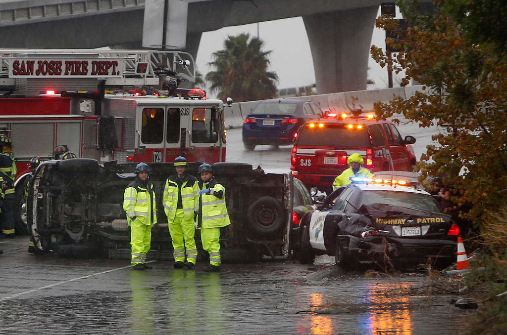 . A California Highway Patrol squad car was struck while working along flooded Highway 87 in San Jose, Calif., Thursday afternoon, Dec. 11, 2014. (Karl Mondon/Bay Area News Group)