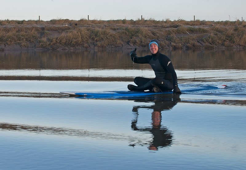 How could I ignore him? Great pose, lovely reflections, and even his hood matches his board. He doesn't look cold neither, which is amazing as it was well below freezing....although the water was warmer!  All photos captured with Olympus E3 and 12-60mm/50-200mm SWD lenses.