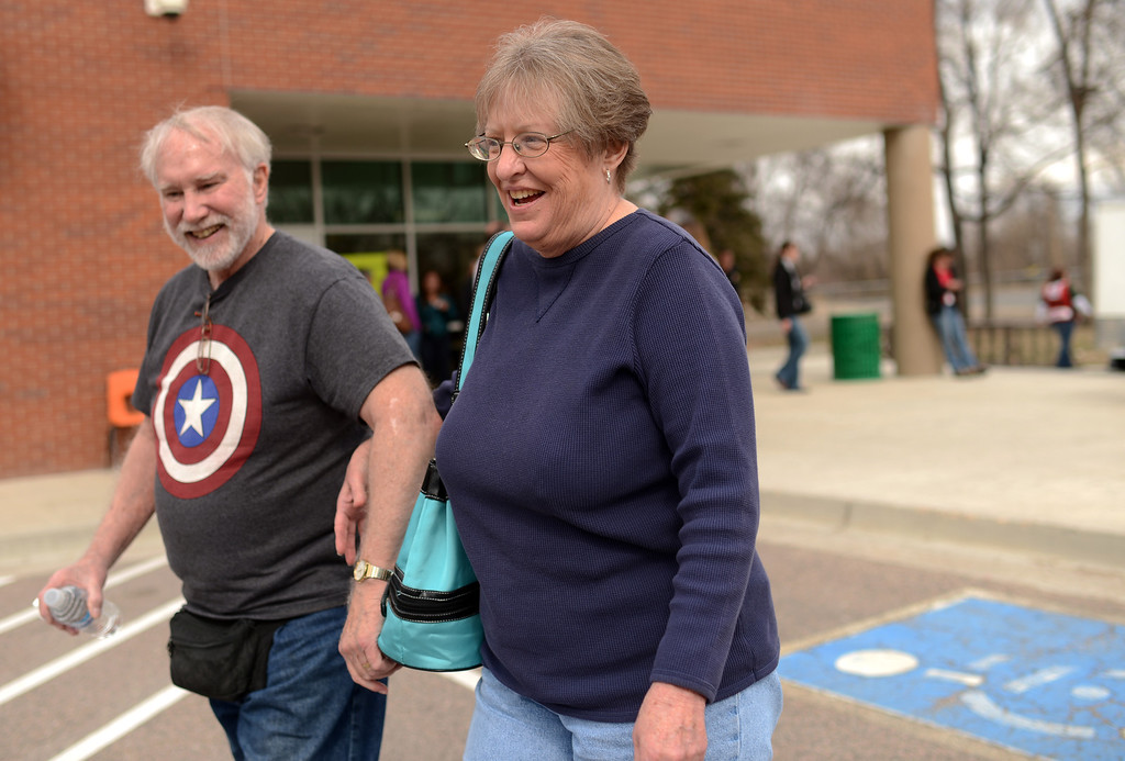 . FORT COLLINS, CO. - MARCH 16: Evacuees Frank Aaron, 70, left, and his wife Janet, 68, head to the parking lot after the resident\'s briefing at the Cache La Pourdre Schools. William Nelson, Larimer Under Sheriff, told homeowners evacuated by the Gelena wildfire that they can return to their homes by 8 p.m. Saturday. Fort Collins, Colorado. March 16, 2013. (Photo By Hyoung Chang/The Denver Post)