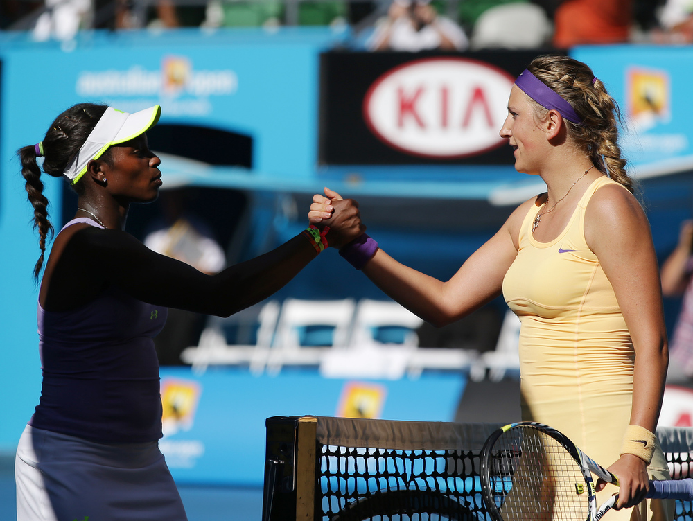 . Sloane Stephens, left, of the US congratulates Victoria Azarenka of Belarus after their semifinal match at the Australian Open tennis championship in Melbourne, Australia, Thursday, Jan. 24, 2013. (AP Photo/Aaron Favila)