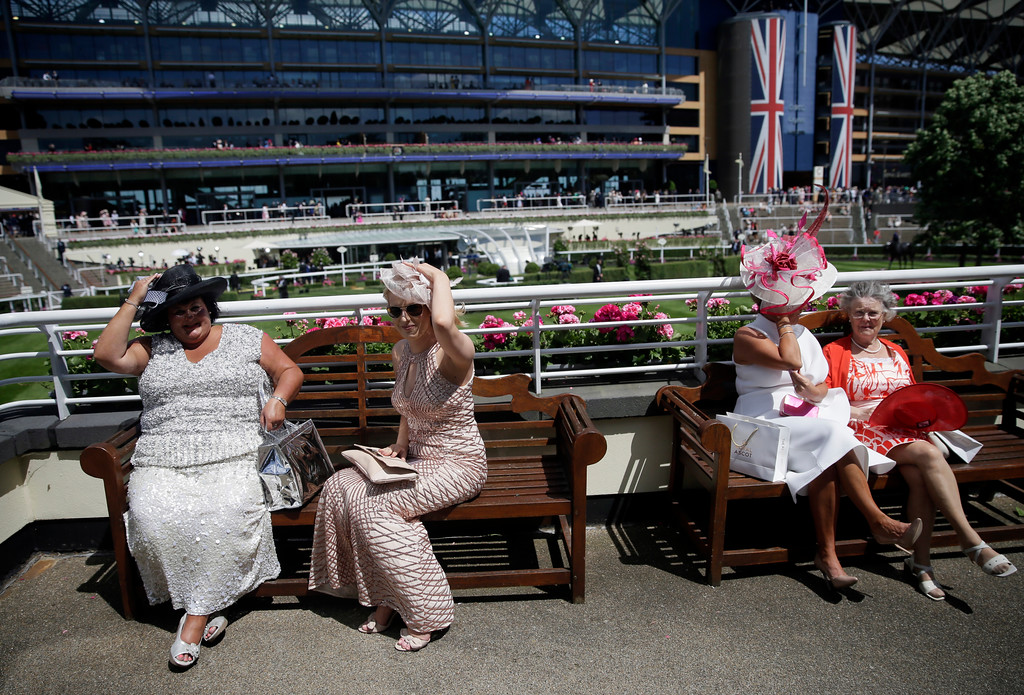 . Racegoers attend the third day of the Royal Ascot horse race meeting, which is traditionally known as Ladies Day, in Ascot, England Thursday, June 21, 2018. (AP Photo/Tim Ireland)