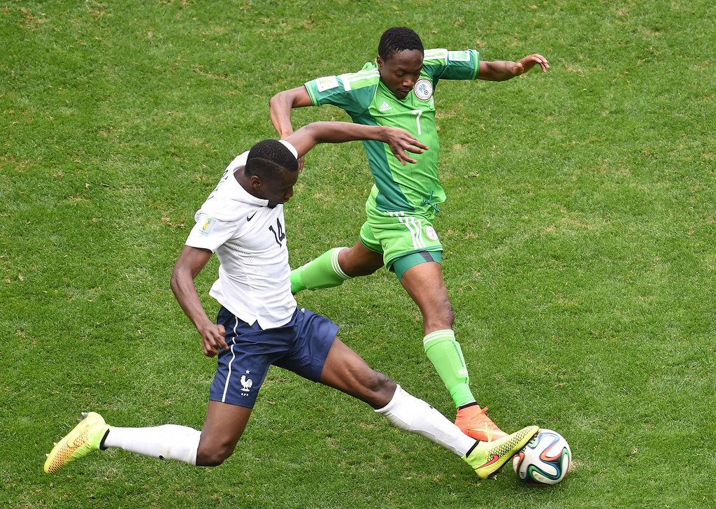 . France\'s midfielder Blaise Matuidi (L) vies with Nigeria\'s forward Ahmed Musa during a Round of 16 football match between France and Nigeria at Mane Garrincha National Stadium in Brasilia during the 2014 FIFA World Cup on June 30, 2014.   EVARISTO SAEVARISTO SA/AFP/Getty Images