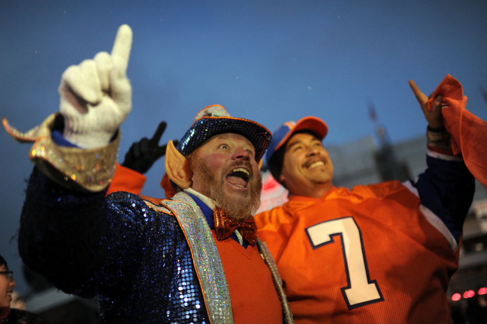 . Rocky the Lepreshaun, left, and Denver Broncos fans are in the United in Orange Pep Rally at Sports Authority Field at Mile High in Denver on Friday. Denver. CO, January 11, 2013.  Hyoung Chang, The Denver Post