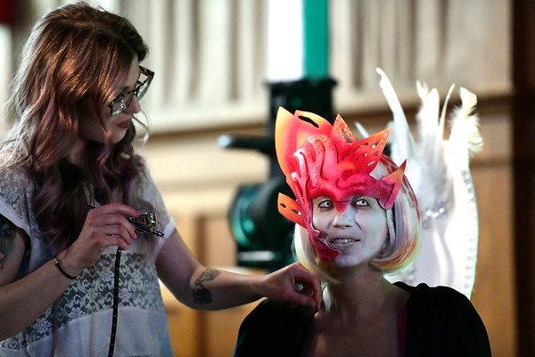 3/30/2019 Mike Orazzi | Staff Gina DeGiacomo while being painted by Kaylee Doll during Swan Day CT held at Trinity on Main in New Britain Saturday night.