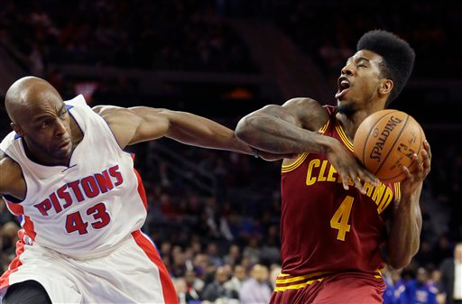 . Cleveland Cavaliers guard Iman Shumpert (4) is fouled by Detroit Pistons forward Anthony Tolliver (43) during the first half of an NBA basketball game, Tuesday, Feb. 24, 2015 in Auburn Hills, Mich. (AP Photo/Carlos Osorio)