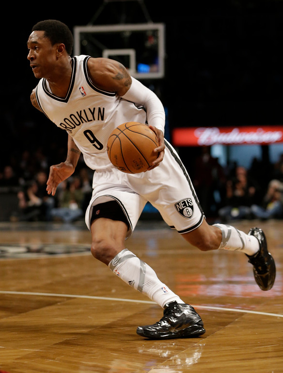 . Brooklyn Nets guard MarShon Brooks (9) drives in the first half of their their NBA basketball game, Monday, April 15, 2013, in New York. (AP Photo/Kathy Willens)