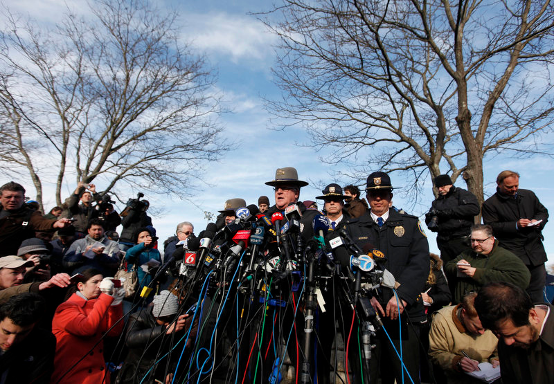 Description of . Lt. J. Paul Vance of the Connecticut State Police conducts a news briefing, Saturday, Dec. 15, 2012 in Newtown, Conn. The massacre of 26 children and adults at Sandy Hook Elementary school elicited horror and soul-searching around the world even as it raised more basic questions about why the gunman, 20-year-old Adam Lanza, would have been driven to such a crime and how he chose his victims. (AP Photo/Jason DeCrow)