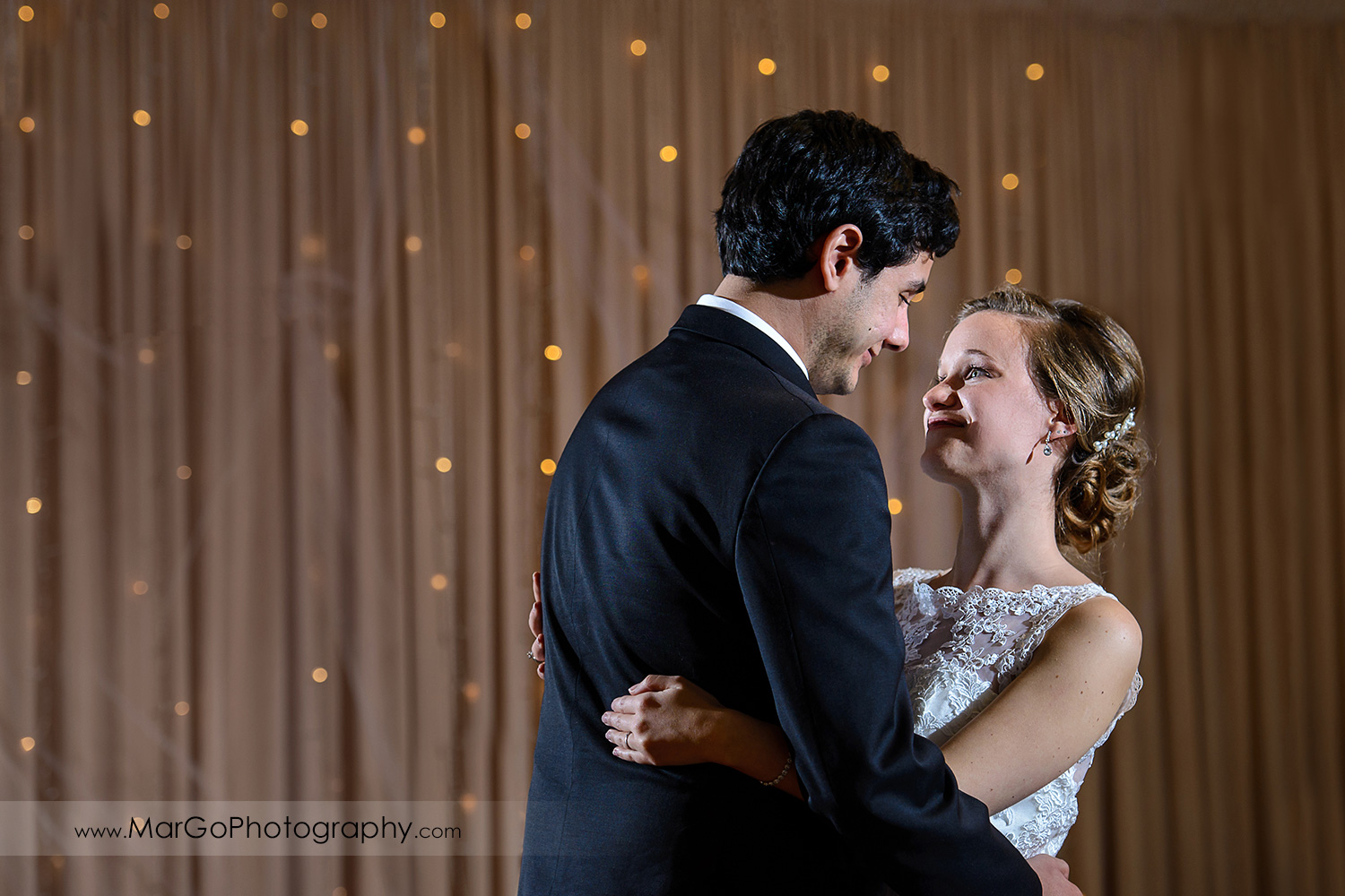 first dance of bride and groom during wedding reception at Fremont Century House & Gardens