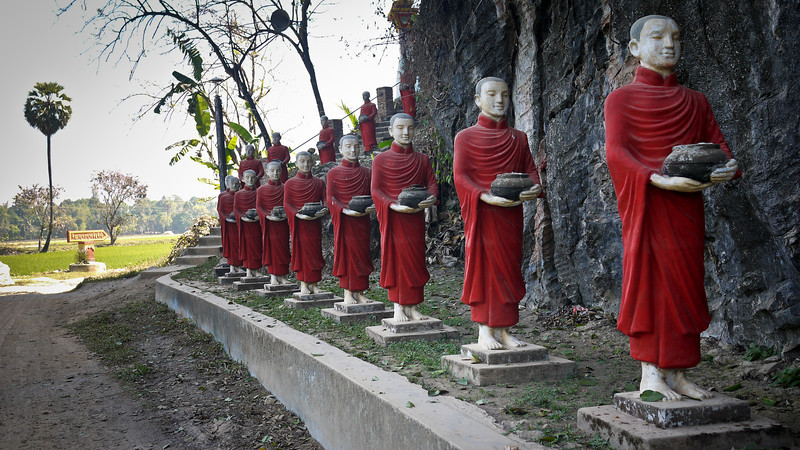 A row of monk statues near Kawkathaung and Ruby Caves outside of Hpa-An, Burma.