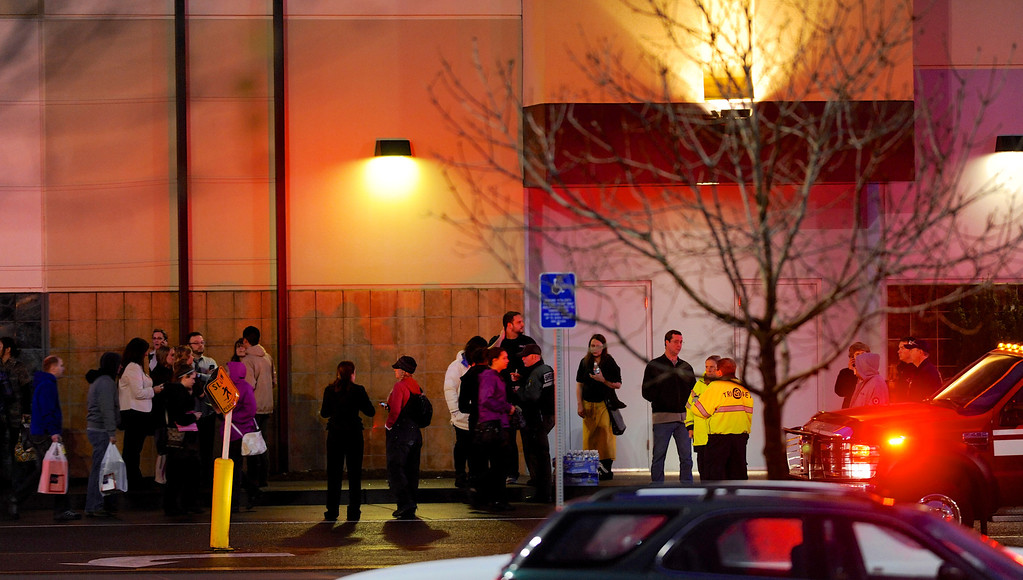 . Shoppers wait to be evacuated outside the scene of a multiple shooting at Clackamas Town Center Mall in Clackamas, Ore., Tuesday Dec. 11, 2012. A gunman is dead after opening fire in the Portland, Ore., area shopping mall Tuesday, killing two people and wounding another, sheriff\'s deputies said. (AP Photo/Greg Wahl-Stephens)