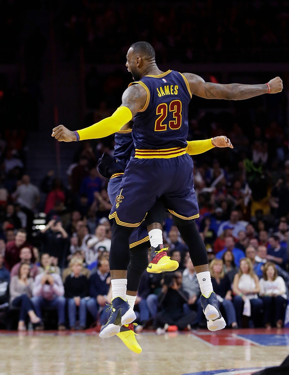 . Cleveland Cavaliers forward LeBron James celebrates with guard Kyrie Irving after Irving\'s 3-point basket during the second half in Game 3 of the first round of the NBA playoffs against the Detroit Pistons on April 22 in Auburn Hills, Mich. James led the Cavs in assists and rebounds, with 7 and 13, respectively. Irving led the Cavs in points with 26, in the team\'s 101-91 victory. Cleveland leads the series, 3-0. (AP Photo/Carlos Osorio)