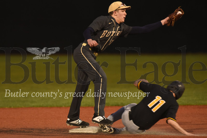 Butler's Cooper Baxter reaches for the ball to try to make a play at second in Monday night's loss to North Allegheny.