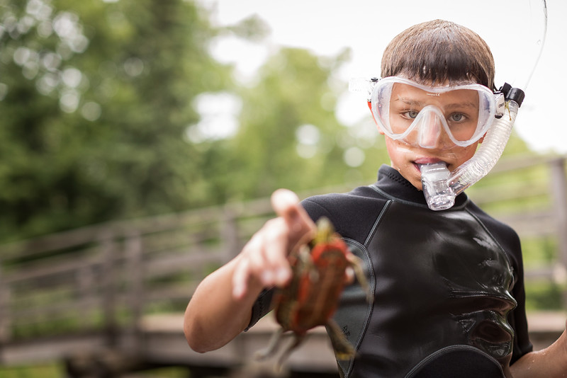 A young boy wearing a snorkel.