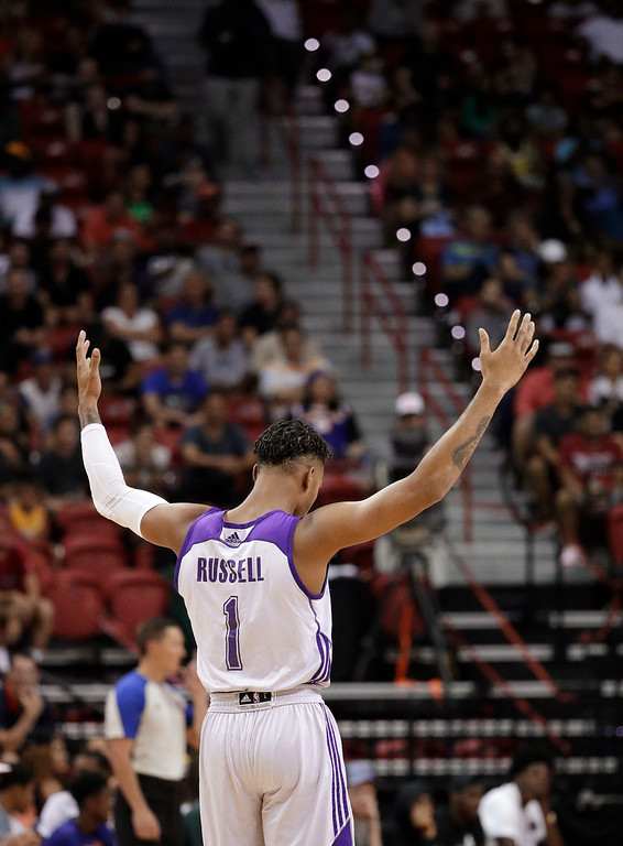 . Los Angeles Lakers\' DAngelo Russell celebrates after a play against the Cleveland Cavaliers during the first half of an NBA summer league basketball game Thursday, July 14, 2016, in Las Vegas. (AP Photo/John Locher)