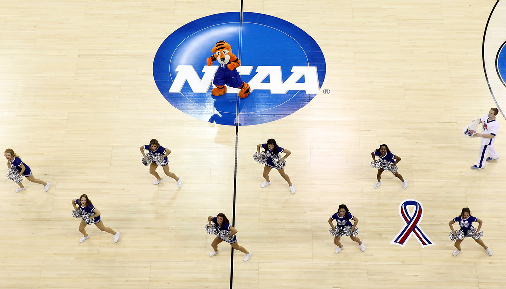 . The Memphis Tigers cheerleaders and mascot perform on the court in the game against the Virginia Cavaliers during the third round of the 2014 NCAA Men\'s Basketball Tournament at PNC Arena on March 23, 2014 in Raleigh, North Carolina.  (Photo by Streeter Lecka/Getty Images)