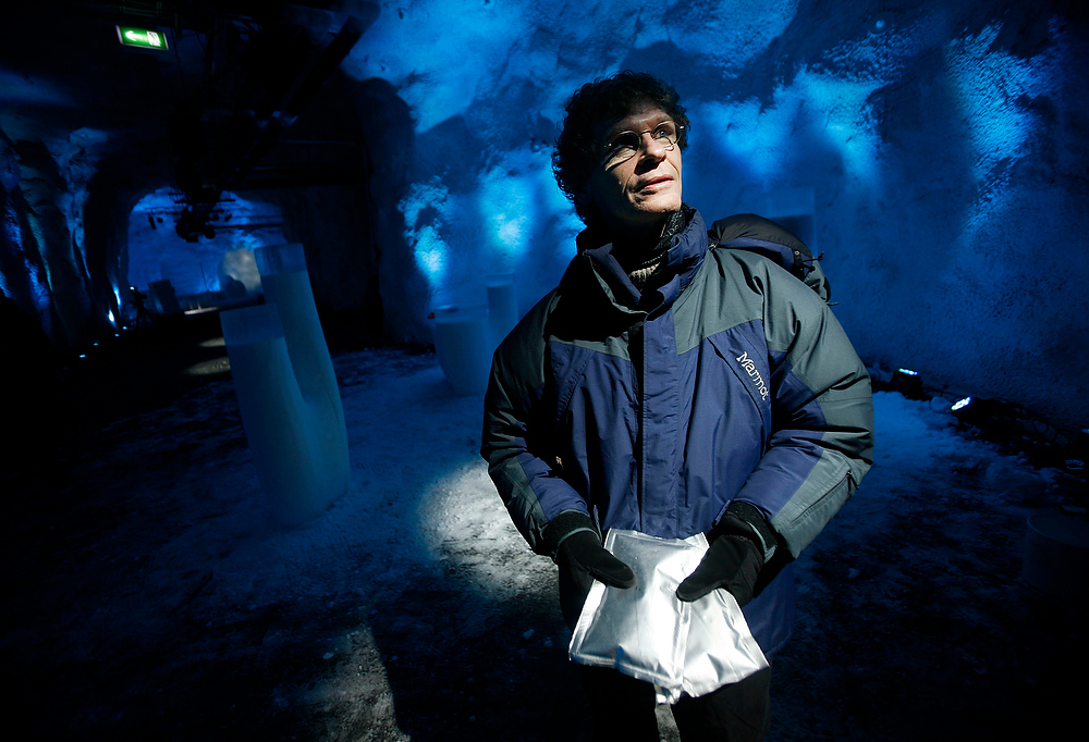". Cary Fowler, the Executive Director of the Global Crop Diversity Fund, holds seeds inside the Svalbard Global Seed Vault Monday Feb. 25, 2008 in Longyearbyen, Norway. A ""doomsday\"" vault built to withstand an earthquake or nuclear strike is ready to open deep in the permafrost of an Arctic mountain, where it will protect millions of agriculture seeds from man-made and natural disasters. About 620 miles from the North Pole, the vault has the capacity to store 4.5 million seed samples from around the globe, shielding them from climate change, wars, natural disasters and other threats. (AP Photo/John McConnico)"