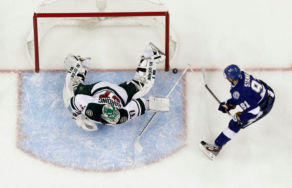 . Minnesota Wild goalie Josh Harding stopped this shot by Steven Stamkos, but the Tampa Bay Lightning center scored the winning goal on a breakaway against Harding late in the third period as the Wild lost 3-1 Thursday, Oct. 17, 2013, in Tampa, Fla. (AP Photo/Chris O\'Meara)