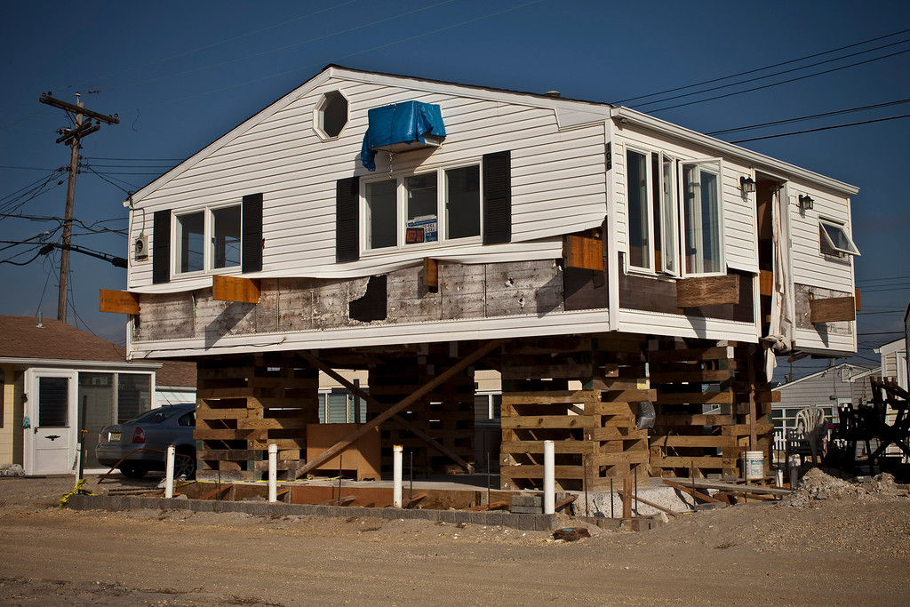 . A house remains under construction one year after being partially destroyed by Superstorm Sandy, October 29, 2013 in Dover Beach North, New Jersey. (Photo by Kena Betancur/Getty Images)