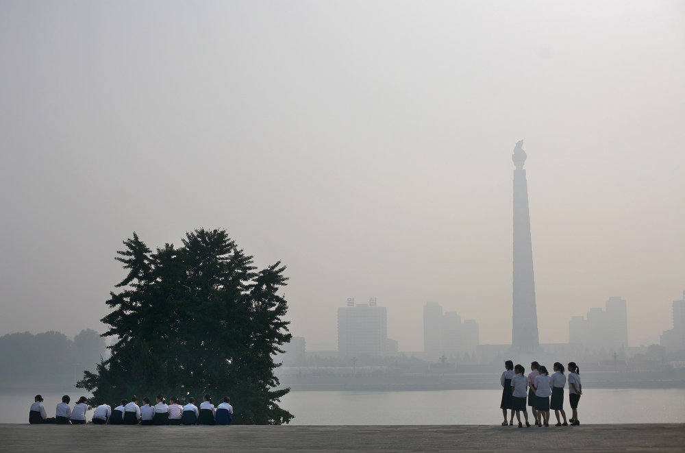 . North Korean school girls visit the riverside in front of Juche Tower in Pyongyang, North Korea on Wednesday, Sept. 17, 2008. (AP Photo/David Guttenfelder)