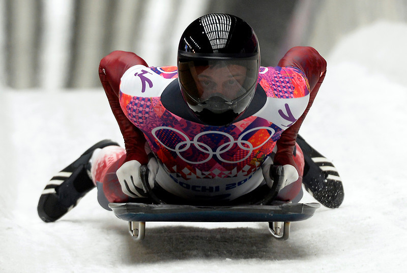 . Latvia\'s Martins Dukurs finishes the Men\'s Skeleton Heat 4 and final run at the Sanki Sliding Center in Rosa Khutor during the Sochi Winter Olympics on February 15, 2014. (LIONEL BONAVENTURE/AFP/Getty Images)
