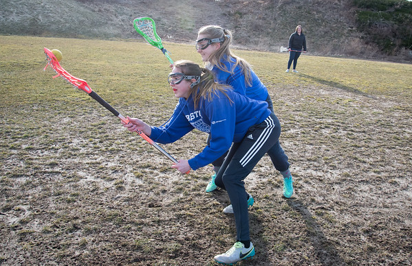 03/18/19 Wesley Bunnell | Staff Seniors Allison Jessie, front, and Corinna Marsh run a drill during the Bristol Central girls lax team workout on Monday afternoon.