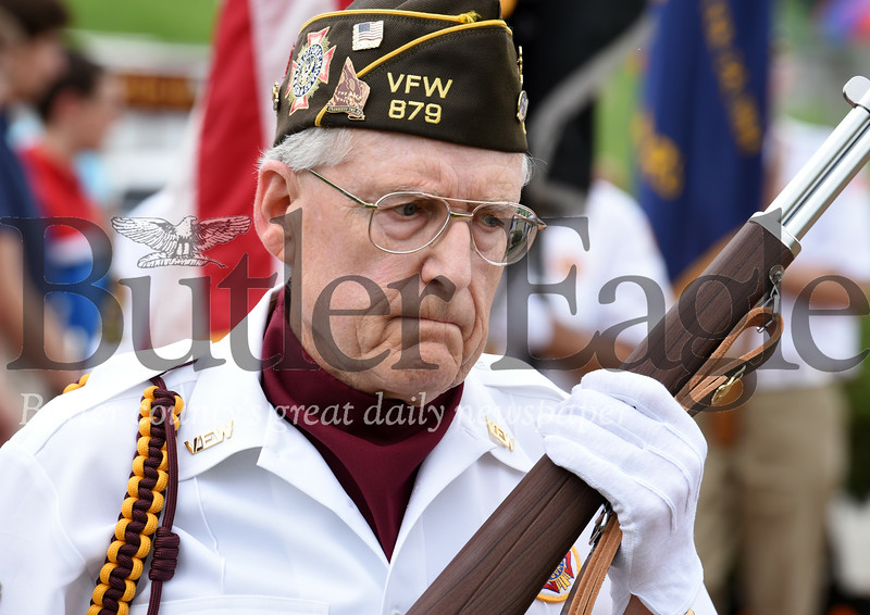 Harold Aughton/Butler Eagle: Paul Hughes of Butler leads the Color Guard for the VFW Post 879 during the Memorial Day ceremony held at the North Boundary Park in Cranberry Twp.