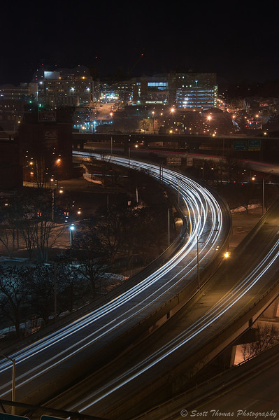 Light streaks from cars on Route 81 traveling through the center of Syracuse, New York.