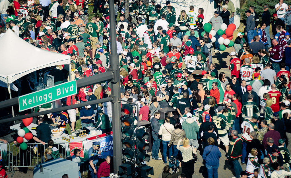 . Crowds swarm the corner of West 7th Street and Kellogg Boulevard during a block party outside Xcel Energy Center prior to the start of Game 3.  (Pioneer Press: Ben Garvin)