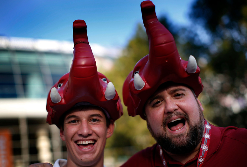 . Alabama Crimson Tide fans wear elephant hats outside Sun Life stadium before the BCS National Championship college football game between Alabama and the Notre Dame Fighting Irish in Miami, Florida January 7, 2013. REUTERS/Mike Segar