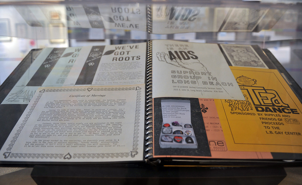 """. 2/19/13 - \""""Coming Out in Long Beach\"""" is the Historical Society of Long Beach\'s latest exhibit. Opening Feb. 26, the year long display chronicles the gay community\'s struggle for equality and justice. The timeline begins in 1914 through today. This scrapbook belonged to artist Ray Lowen.  Photo by Brittany Murray / Staff Photographer"""