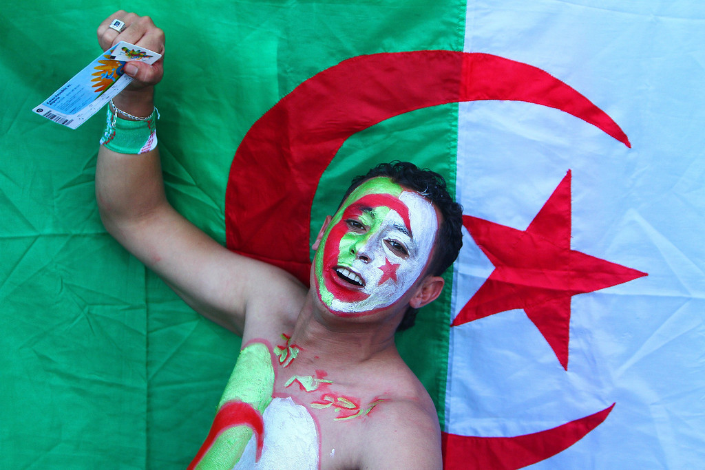 . Supporters of Algeria poses for a picture outside the Beira-Rio Stadium as he waits to watch the Algeria vs South Korea World Cup match on June 22, in Porto Alegre, Brazil.   Lucas Uebel/AFP/Getty Images