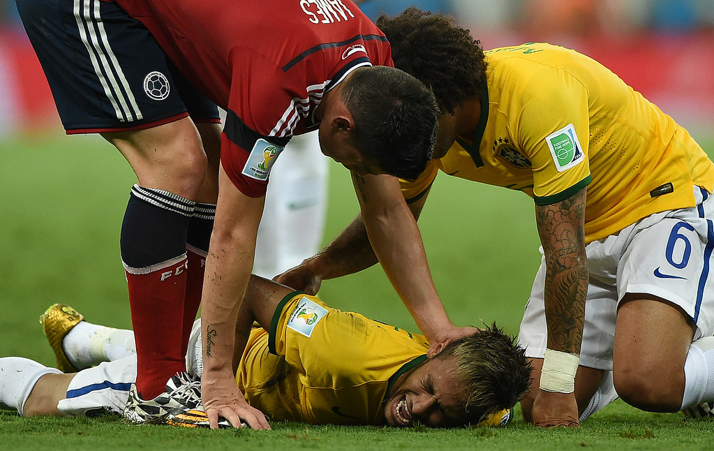 . Brazil\'s forward Neymar (C) lies on the pitch after being injured during the quarter-final football match between Brazil and Colombia at the Castelao Stadium in Fortaleza during the 2014 FIFA World Cup on July 4, 2014. EITAN ABRAMOVICH/AFP/Getty Images