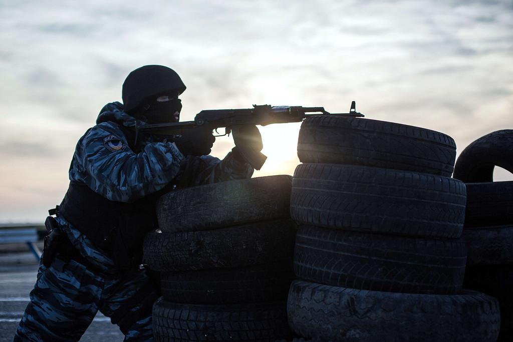 . An armed pro-Russian serviceman stands guard at Chongar checkpoint blocking the entrance to Crimea on March 10, 2014. Russia vowed on March 10 to unveil its own solution to the Ukrainian crisis that would run counter to US efforts and would appear to leave room for Crimea to switch over to Kremlin rule. The unexpected announcement came as Ukraine\'s new pro-European leaders raced to rally Western support in the face of the seizure by Kremlin-backed forces of the strategic Black Sea peninsula and plans to hold a Sunday referendum on switching Crimea\'s allegiance from Kiev to Moscow. ALISA BOROVIKOVA/AFP/Getty Images