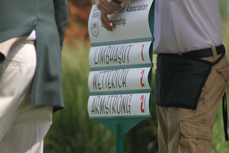 The standard bearing the names and scores of the leading group heading into the third round of the 2014 Western Junior Championship.