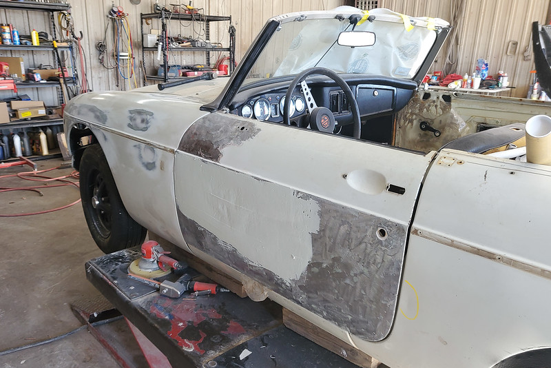 Grinding down the old paint, filling in the dents