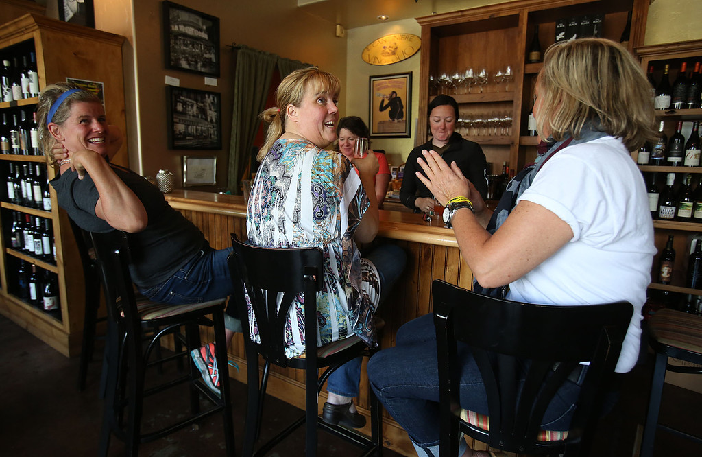 . Lee McCune, right, talks with Sherry Horton, center, and Tanya Olson to celebrate the news of U.S. Army Sgt. Bowe Bergdahl\'s release on Saturday, May 31, 2014 in Hailey, Idaho, his hometown. Bergdahl, 28, had been held prisoner by the Taliban since June 30, 2009. He was handed over to U.S. special forces by the Taliban in exchange for the release of five Afghan detainees held by the United States. McCune, who knows Bergdahl, has worn yellow bracelets to show support during his captivity. (AP Photo/The Times-News, Ashley Smith)