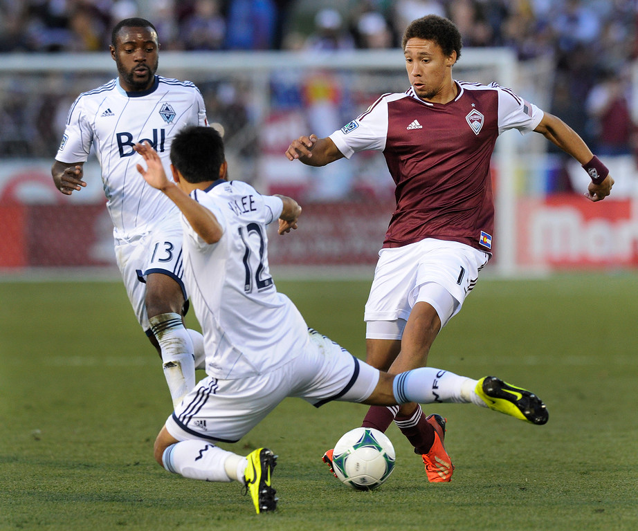 . COMMERCE CITY, CO. - OCTOBER 19: Colorado defender Christopher Klute (15) tried to get the ball past Vancouver\'s Y.P. Lee (12) in the second half. The Colorado Rapids defeated the Vancouver Whitecaps 3-2 at Dick\'s Sporting Goods Park Saturday, October 19, 2013. Photo By Karl Gehring/The Denver Post