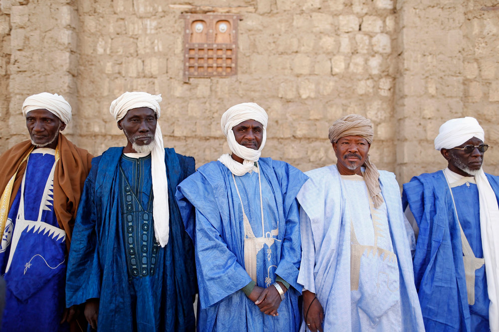 "Description of . People gather to greet French President Francois Hollande at the Djingareiber mosque, in the center of Timbuktu February 2, 2013. Malians chanting ""Thank you, France!\"" mobbed Hollande on Saturday as he visited the desert city of Timbuktu, retaken from Islamist rebels, and pledged France\'s sustained support for Mali to expel jihadists. REUTERS/Benoit Tessier"