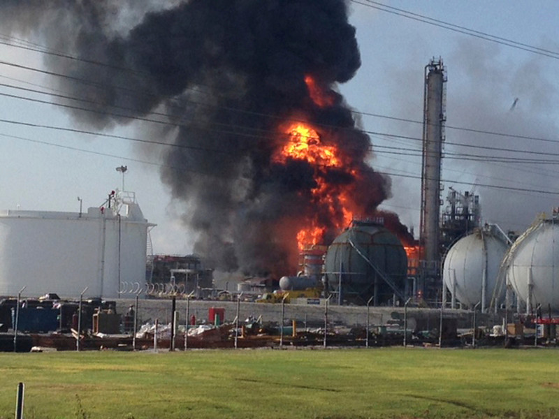 . A large fire burns at the Williams Olefins chemical plant in Geismar, Louisiana in this picture taken June 13, 2013. An explosion and fire tore through the chemical plant injuring 33 people and leading authorities to order people within two miles (3 km) to remain indoors. The blast created a huge fireball and column of smoke when it hit at 8:37 a.m. (1337 GMT) at the plant along the Mississippi River just south of Baton Rouge and about 60 miles (100 km) up river from New Orleans. REUTERS/Picture courtesy of Ryan Meador/Handout via Reuters