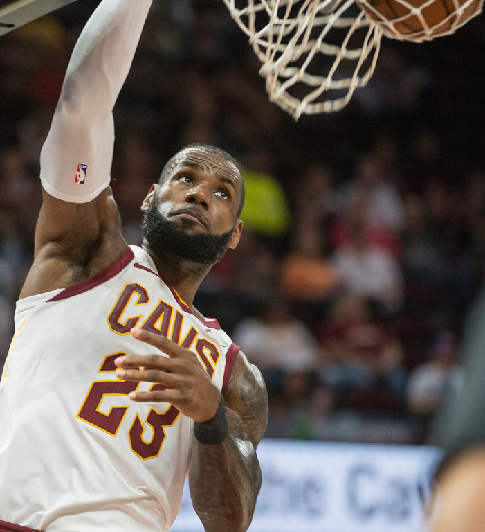 . Cleveland Cavaliers\' LeBron James (23) dunks against the Chicago Bulls during the first half of an NBA preseason basketball game in Cleveland, Tuesday, Oct. 10, 2017. (AP Photo/Phil Long)